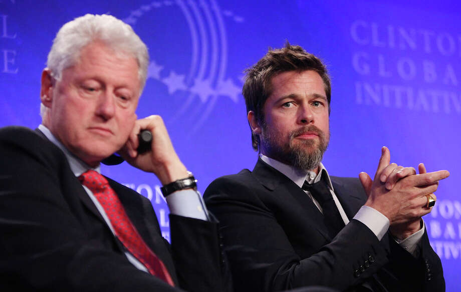 Former President Bill Clinton (L) appears with actor Brad Pitt while discussing post-Katrina New Orleans at the Clinton Global Initiative (CGI) September 24, 2009 in New York City. The fifth annual meeting of the CGI gathers prominent individuals in politics, business, science, academics, religion and entertainment to discuss global issues such as climate change and peace in the Middle East. The event, founded by Clinton after he left office, is held the same week as the General Assembly at the United Nations, when most world leaders are in New York City. Photo: Mario Tama, Getty Images / 2009 Getty Images