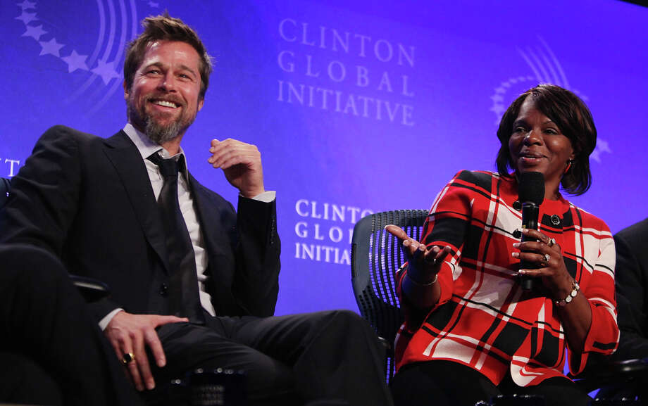 Actor Brad Pitt and Lower Ninth Ward homeowner Deidra Taylor discuss post-Katrina New Orleans at the Clinton Global Initiative (CGI) September 24, 2009 in New York City. Taylor received a new home from Pitt's Make it Right foundation after hers was destroyed by Hurricane Katrina. The fifth annual meeting of the CGI gathers prominent individuals in politics, business, science, academics, religion and entertainment to discuss global issues such as climate change and peace in the Middle East. The event, founded by Clinton after he left office, is held the same week as the General Assembly at the United Nations, when most world leaders are in New York City. Photo: Mario Tama, Getty Images / 2009 Getty Images