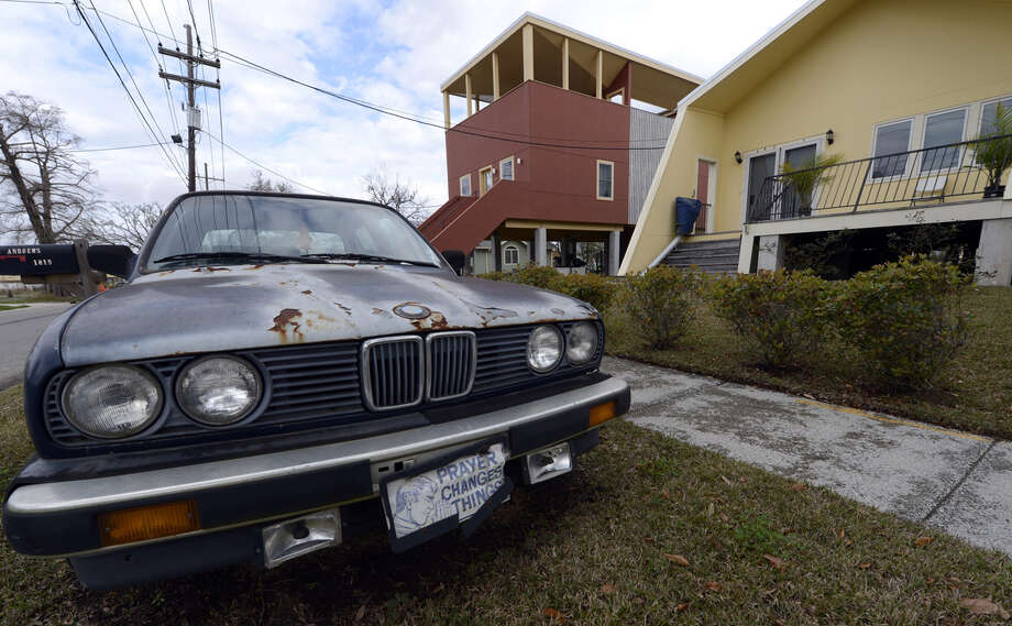 A car sits in front of one of the modular houses built by the Brad Pitt's Make It Right Foundation in the Lower Ninth Ward of New Orleans on February 5, 2013. Pitt rasied  $30 million for the project that consists of hurricane-proof homes. The Ninth Ward suffered the worst damage from Hurricane Katrina that occured in 2005 after multiple breaches in the levees of at least four canals. As of March 2009, hundreds of houses have been rebuilt, and dozens of new homes have been constructed. Photo: TIMOTHY A. CLARY, AFP/Getty Images / 2013 AFP