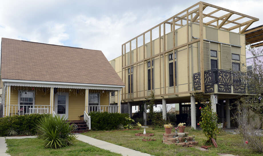 One of the modular houses built by the Brad Pitt's Make It Right Foundation is seen in the Lower Ninth Ward of New Orleans on February 5, 2013. Pitt rasied  $30 million for the project that consists of hurricane-proof homes. The Ninth Ward area suffered the worst damage from Hurricane Katrina that occured in 2005 after multiple breaches in the levees of at least four canals. As of March 2009, hundreds of houses have been rebuilt, and dozens of new homes have been constructed.  AFP PHOTO / TIMOTHY A. CLARY Photo: TIMOTHY A. CLARY, AFP/Getty Images / 2013 AFP