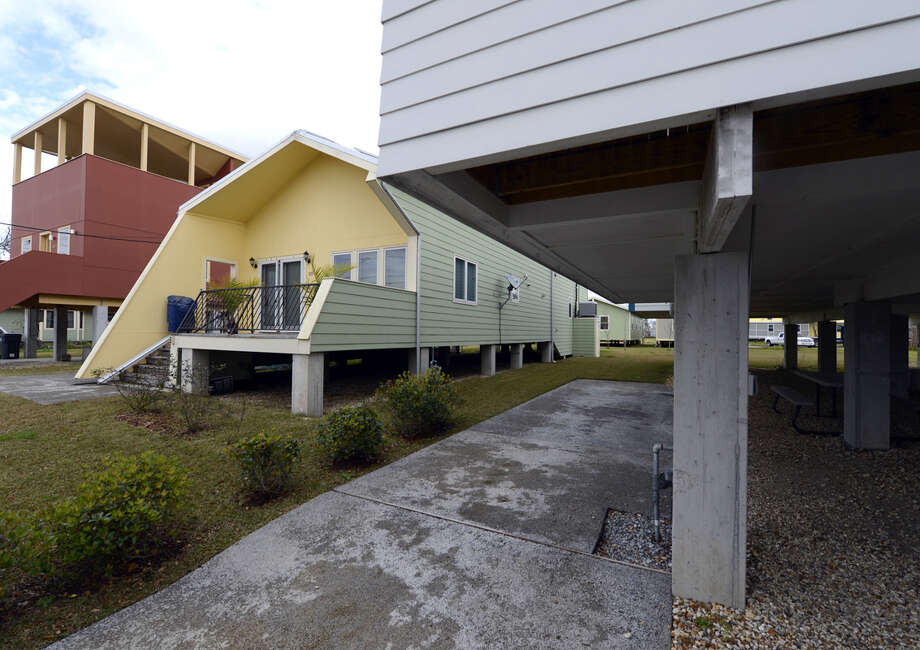 One of the modular houses built by the Brad Pitt's Make It Right Foundation is seen in the Lower Ninth Ward of New Orleans on February 5, 2013. Pitt rasied  $30 million for the project that consists of hurricane-proof homes. The Ninth Ward area suffered the worst damage from Hurricane Katrina that occured in 2005 after multiple breaches in the levees of at least four canals. As of March 2009, hundreds of houses have been rebuilt, and dozens of new homes have been constructed.  Photo: TIMOTHY A. CLARY, AFP/Getty Images / 2013 AFP