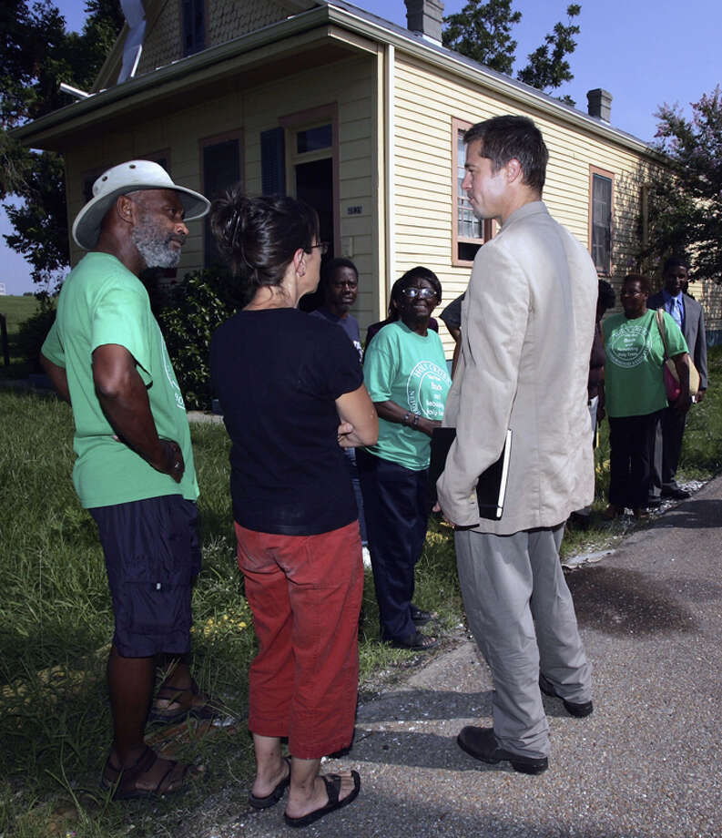 Actor Brad Pitt talks with Holly Cross locals during a trip to lobby government officials to increase the speed of re-construction on July 13, 2006 in New Orleans, Louisiana. Pitt and Global Green USA created a sustainable design architecture competition to showcase affordable, energy-efficient construction.  The competition drew entries from around the world. Photo: Mark Mainz, Getty Images / 2006 Getty Images