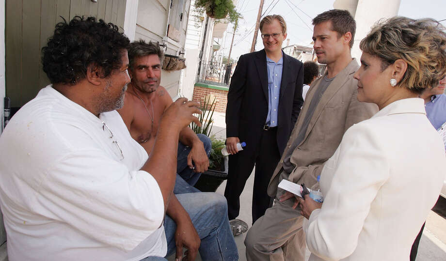Actor Brad Pitt, President and CEO of Global Green USA Matt Petersen and council member Cynthia Willard-Lewis (r) visit areas affected by hurricane Katrina during a trip to lobby government officials to increase the speed of re-construction on July 13, 2006 in New Orleans, Louisiana. Pitt and Global Green USA created a sustainable design architecture competition to showcase affordable, energy-efficient construction.  The competition drew entries from around the world. Photo: M Mainz, Getty Images / 2006 Getty Images