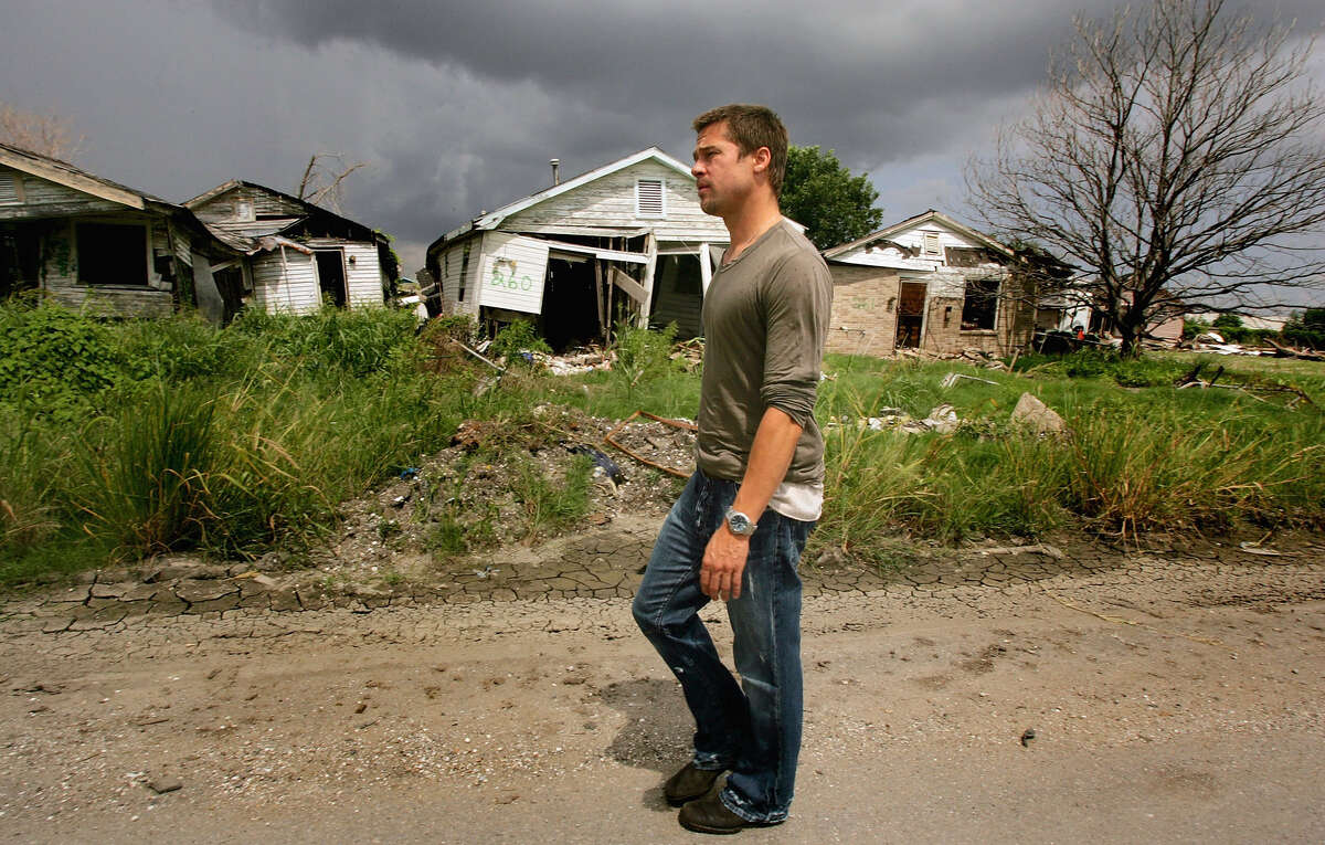 Actor Brad Pitt visits the Lower Ninth Ward of New Orleans during a trip to lobby government officials to increase the speed of re-construction on July 13, 2006 in New Orleans, Louisiana. Pitt and Global Green USA created a sustainable design architecture competition to showcase affordable, energy-efficient construction. The competition drew entries from around the world.