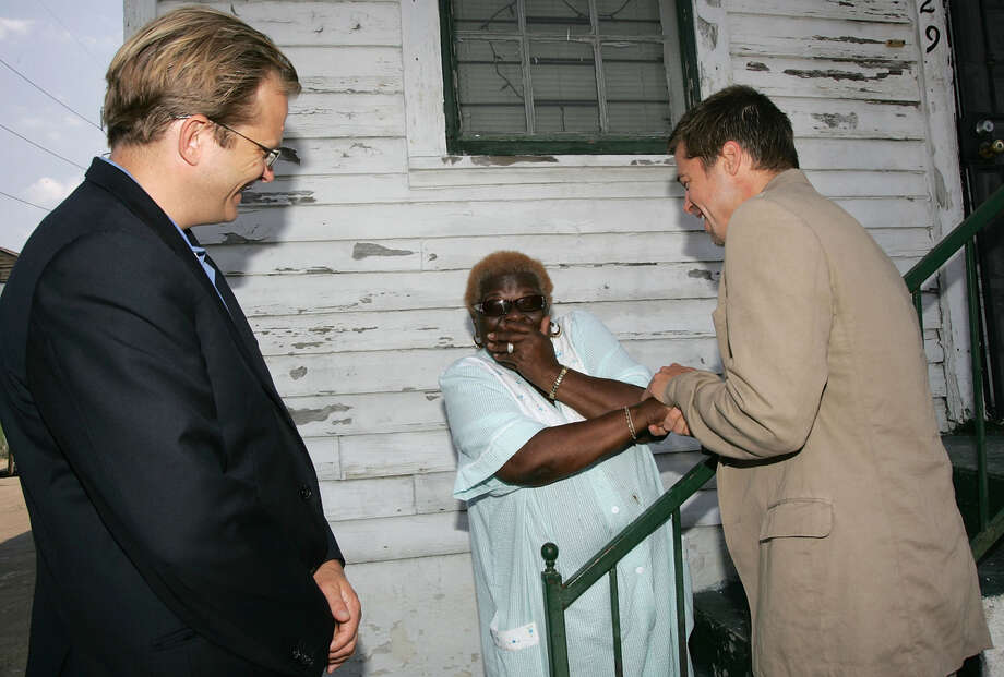 Actor Brad Pitt, President and CEO of Global Green USA Matt Petersen (left) talks with Treme resident Signe Frazier during a trip to lobby government officials to increase the speed of re-construction on July 13, 2006 in New Orleans, Louisiana. Pitt and Global Green USA created a sustainable design architecture competition to showcase affordable, energy-efficient construction.  The competition drew entries from around the world. Photo: M Mainz, Getty Images / 2006 Getty Images