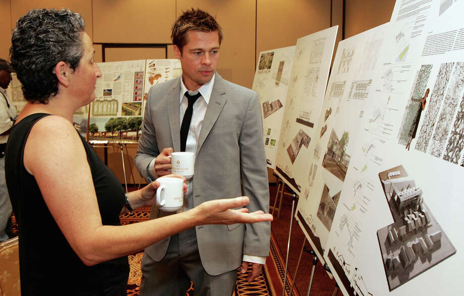 Actor Brad Pitt views the Global Green USA sustainable design architecture competition finalists on August 31, 2006 in New Orleans, Louisiana. Pitt and Global Green USA created a sustainable design architecture competition to showcase affordable, energy-efficient construction.  The competition drew entries from around the world. Photo: Mark Mainz, Getty Images / 2006 Getty Images
