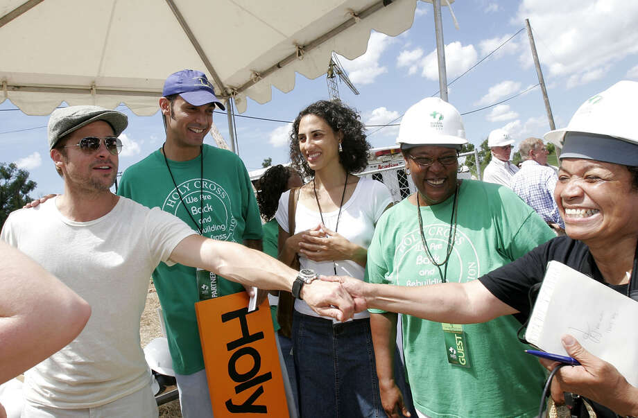 Brad Pitt (L) attends a press conference for the Global Green USA's first house project at the Holy Cross Neigbourhood association project in the 9th ward district, on August 21, 2007 in New Orleans, Louisiana. Photo: Marsaili McGrath, Getty Images / 2007 Getty Images