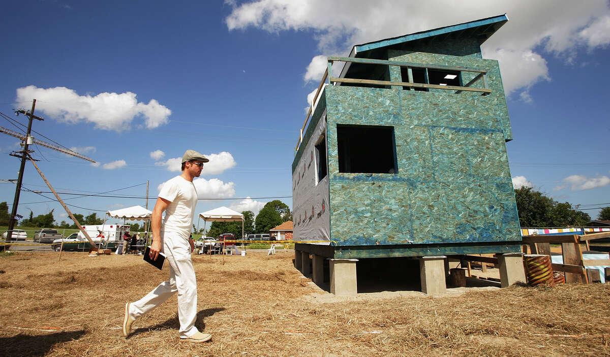 Actor Brad Pitt walks at the site of the Global Green USA's first house project at the Holy Cross Neigbourhood association project in the 9th ward district, on August 21, 2007 in New Orleans, Louisiana.