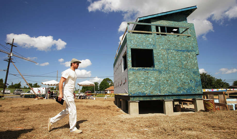 Actor Brad Pitt walks at the site of the Global Green USA's first house project at the Holy Cross Neigbourhood association project in the 9th ward district, on August 21, 2007 in New Orleans, Louisiana. Photo: Mark Mainz, Getty Images / 2007 Getty Images