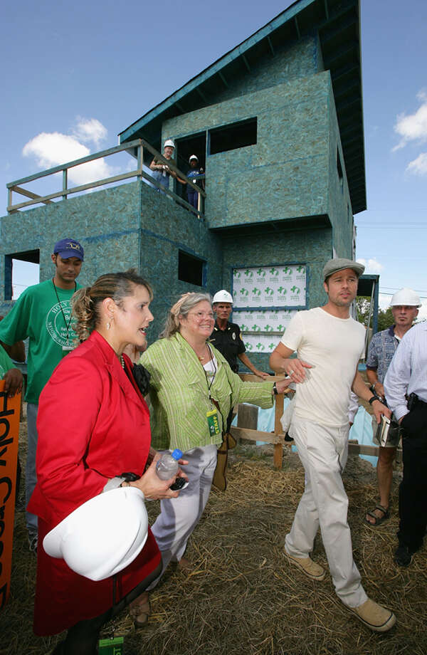 NEW ORLEANS - AUGUST 21:  Brad Pitt (R) and council member Cynthia Willard-Lewis (L) attend a press conference for the Global Green USA's first house project at the Holy Cross Neighbourhood association project in the 9th ward district August 21, 2007 in New Orleans, Louisiana. Photo: Mark Mainz, Getty Images / 2007 Getty Images
