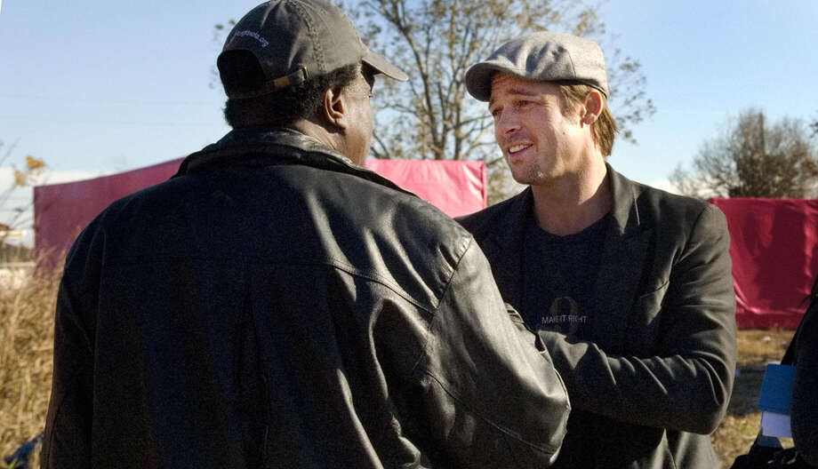 "US actor Brad Pitt (R) greets Robert Green (L) during a press conference 03 December 2007 in the Lower 9th Ward of New Orleans, Louisiana on Pitt's plans to spend USD12 million with his ""Make It Right Project"" for 150 ecologically sustainable homes to be built where levees broke and floodwater pushed houses from their foundations in August 2005. Green lost his granddaughter and mother in the aftermath of Hurricane Katrina.      AFP PHOTO/Matthew HINTON Photo: AFP, AFP/Getty Images / 2007 AFP"