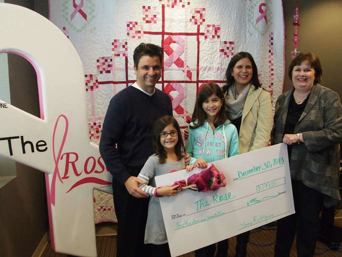 Fernando, Siena, Viana and Gaby Rodrigues closed out 2013 with a check presentation to Bernice Joseph, COO of The Rose.