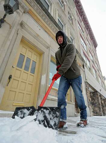 Jonathan Moya of Schenectady shovels the sidewalk in front of 100 Jay St. on Thursday, Jan. 2, 2014 in Schenectady, N.Y. (Lori Van Buren / Times Union) Photo: Lori Van Buren / 00025207A