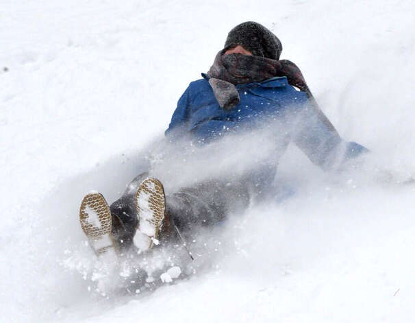 Thomas Zaloga, 10, of Latham slides down a hill Thursday, JAn. 2, 2014, in Colonie, N.Y. (Skip Dickstein/Times Union)