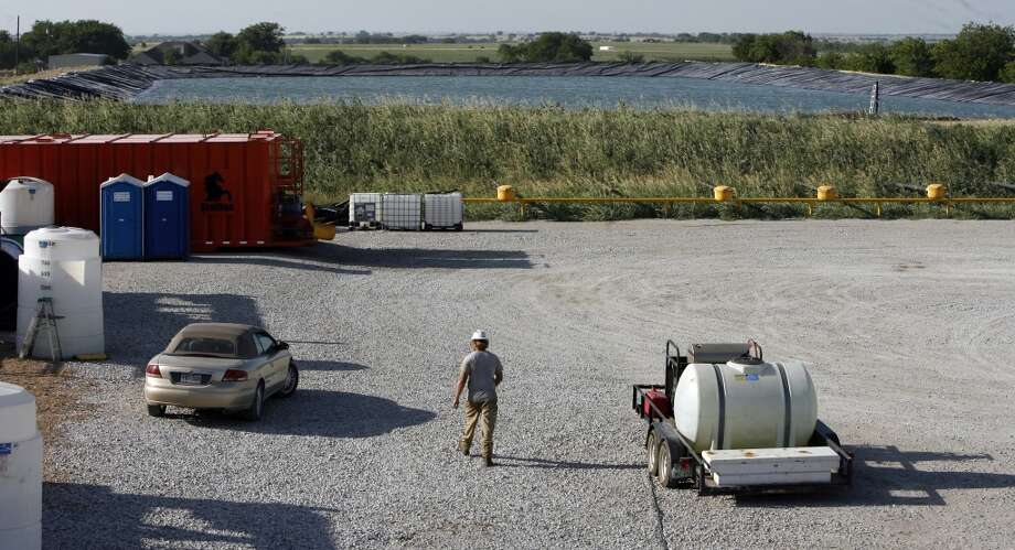 Devon Energy recycles water for use in getting out natural gas in the Barnett Shale Tuesday, June 10, 2008, near Denton. The Barnett Shale is the largest natural gas play in Texas. Photo: Kevin Fujii, Houston Chronicle