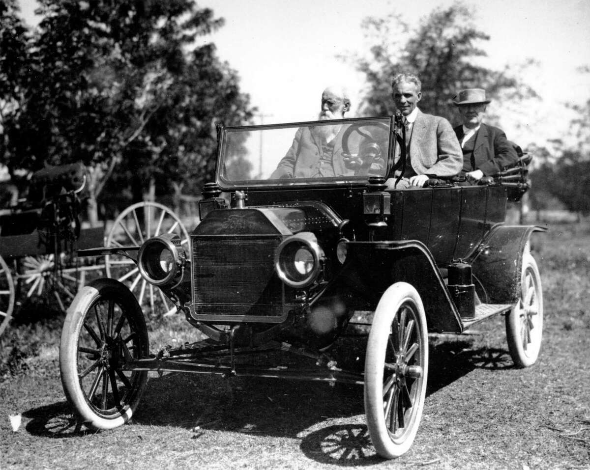 American industrialist Henry Ford and inventor Thomas Edison, seated in the back, are seen on one of Ford's automobiles at an unknown location in Florida in this 1914 photo. The man on the left is unidentified.