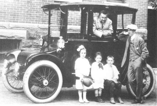 Noted electrical engineer Charles Steinmetz in his 1914 Detroit Electric, with grandchildren (left to right) Midge, Billy and Joe, and his adopted son, Joseph Hayden in this undated photograph. (Union College archives)
