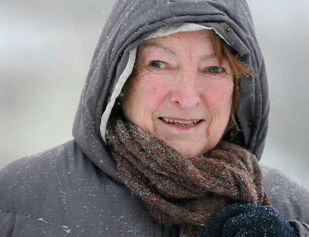 "Evelyn Horwood of Schenectady takes a walk during a snow storm on Thursday, Jan. 2, 2014 in Schenectady, N.Y. Horwood said ""I was starting to get cabin fever and needed to get out of my apartment."" (Lori Van Buren / Times Union) Photo: Lori Van Buren / 00025207A"