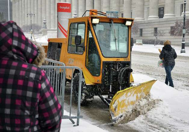 An OGS plow clears sidewalks along Washington Avenue in front of the Capitol Thursday Jan. 2, 2014, in Albany, NY.  (John Carl D'Annibale / Times Union) Photo: John Carl D'Annibale / 00025207A