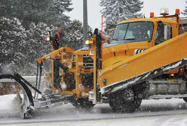 A NYS DOT plow clears an off ramp from I90 Thursday Jan. 2, 2014, in Albany, NY.  (John Carl D'Annibale / Times Union) Photo: John Carl D'Annibale / 00025207A
