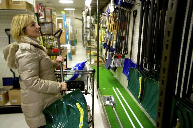 Susan Calabrese looks at shovels at Karps True Value in Stamford, Conn., on Thursday, January 2, 2014. Photo: Lindsay Perry / Stamford Advocate