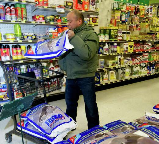 Edwin Mojica buys rock salt at Karps True Value in Stamford, Conn., on Thursday, January 2, 2014. Photo: Lindsay Perry / Stamford Advocate