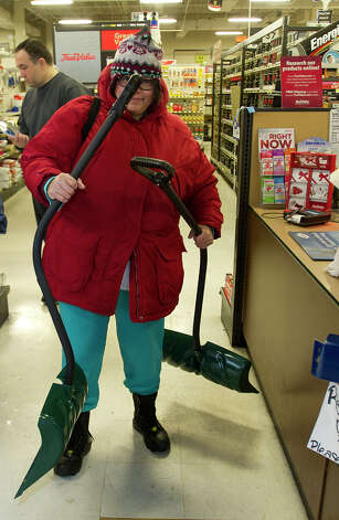 Dionysia Oliveira buys shovels at Karps True Value in Stamford, Conn., on Thursday, January 2, 2014. Photo: Lindsay Perry / Stamford Advocate