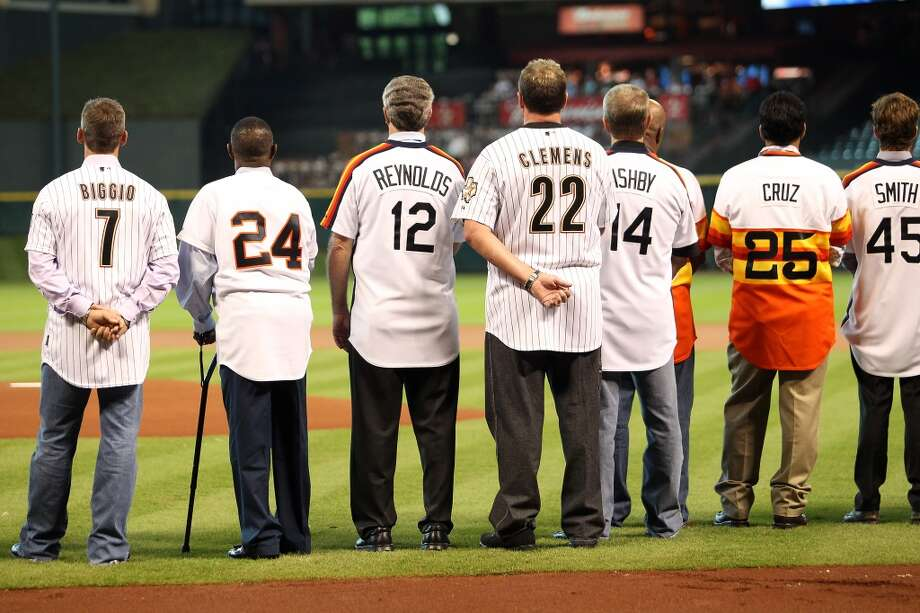 Craig Biggio, Jimmy Wynn, Craig Reynolds, Roger Clemens, Alan Ashby and Jose Cruz during the National Anthem during the Astros 50th Anniversary ceremony before the start of an MLB baseball game at Minute Maid Park on Saturday, Sept. 22, 2012, in Houston.  ( Karen Warren / Houston Chronicle ) Photo: Houston Chronicle
