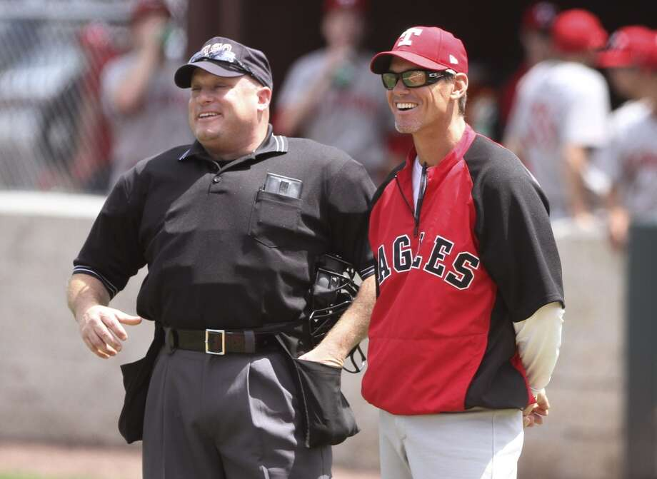 St. Thomas coach and former Houston Astro Craig Biggio laughs with an umpire before a high school baseball game against College Park on Saturday, April 6, 2013, in The Woodlands, Texas. (AP Photo/The Courier, Jason Fochtman) Photo: Associated Press