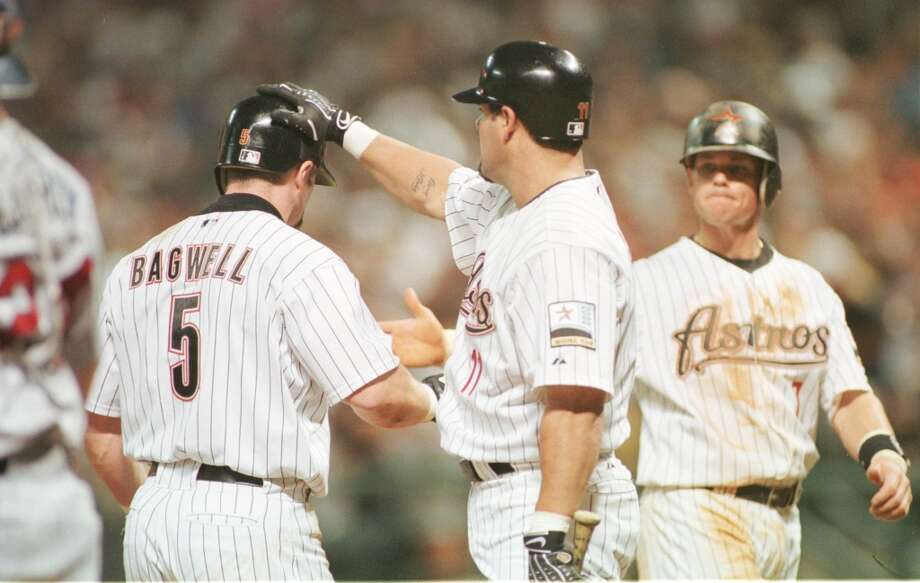 The Houston Astros' Jeff Bagwell receives congratulations from  Ken Caminiti and Craig Biggio after a two run homer in the 6th inning at Enron Field in Houston, Texas Monday night, June 5, 2000. (D. Fahleson/ Houston Chronicle) Photo: Houston Chronicle