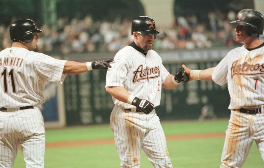 The Houston Astros' Jeff Bagwell receives congratlulations from  Ken Caminiti and Craig Biggio after a two run homer in the 6th inning at Enron Field in Houston, Texas Monday night, June 5, 2000.(Camilla McElligott/ Houston Chronicle) HOUCHRON CAPTION (06/06/2000-2-STAR):  Congratulations were in order for Jeff Bagwell (center) from Ken Caminiti and Craig Biggio after Bagwell's two-run homer gave him 1,000 career RBI's.     HOUCHRON CAPTION (06/06/2000):  Upon reaching a career milestone, Jeff Bagwell is greeted by two players, Ken Caminiti, left, and Craig Biggio, who have seen many of his 1,000 RBIs. Photo: Houston Chronicle