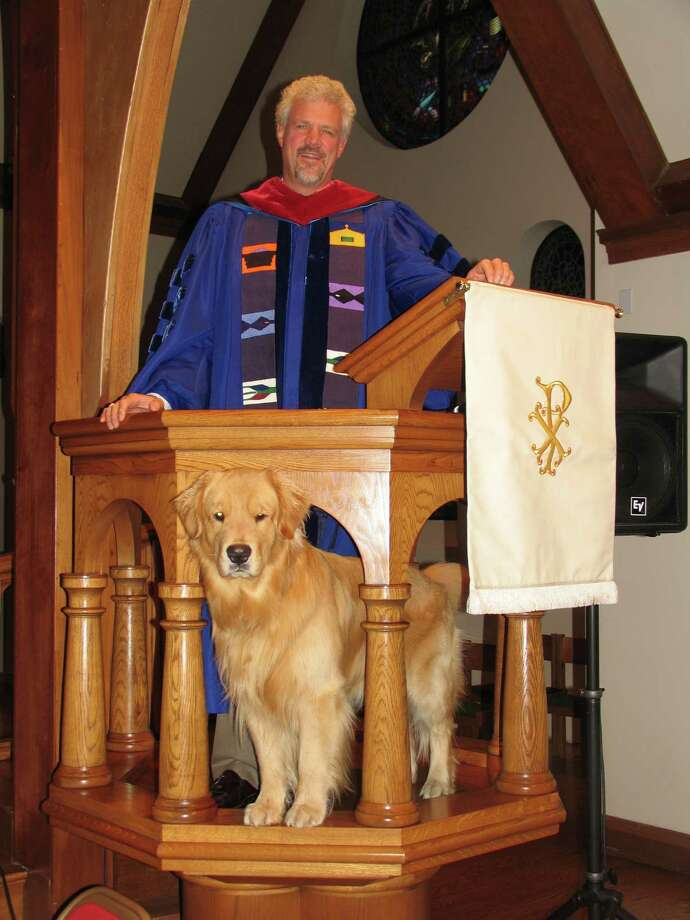 "The Rev. William ""Bill"" Evertsberg is leaving First Presbyterian Church after 17 years. Here, at his  pre-Christmas sermon, Everstberg is joined by his loyal golden retriever, Dudley, who assisted Evertsberg during the holidays. ìI took the role of a shepherd at Jesusí nativity,î Evertsberg says, ìwith Dudley playing the role of the faithful sheepdog.î Dudley has also stepped in to play Jesusí donkey on Palm Sunday. Photo: Contributed Photo / Greenwich Citizen"