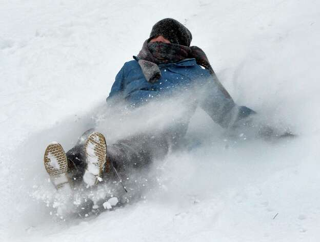 Thomas Zaloga, 10, of Latham gets into the powder while sledding Thursday afternoon, Jan. 2, 2014, near Sand Creek Elementary School in Colonie, N.Y. (Skip Dickstein / Times Union) Photo: SKIP DICKSTEIN
