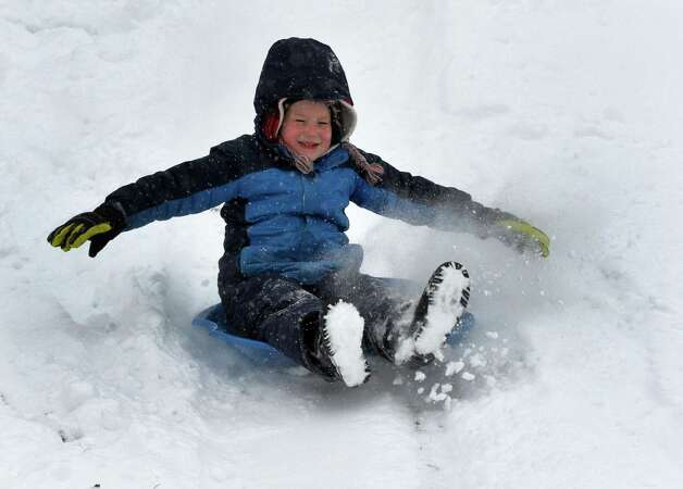 Jonathan Zaloga, 6, of Latham flies over the powder while sledding Thursday afternoon, Jan. 2, 2014, near Sand Creek Elementary School in Colonie, N.Y. (Skip Dickstein / Times Union) Photo: SKIP DICKSTEIN