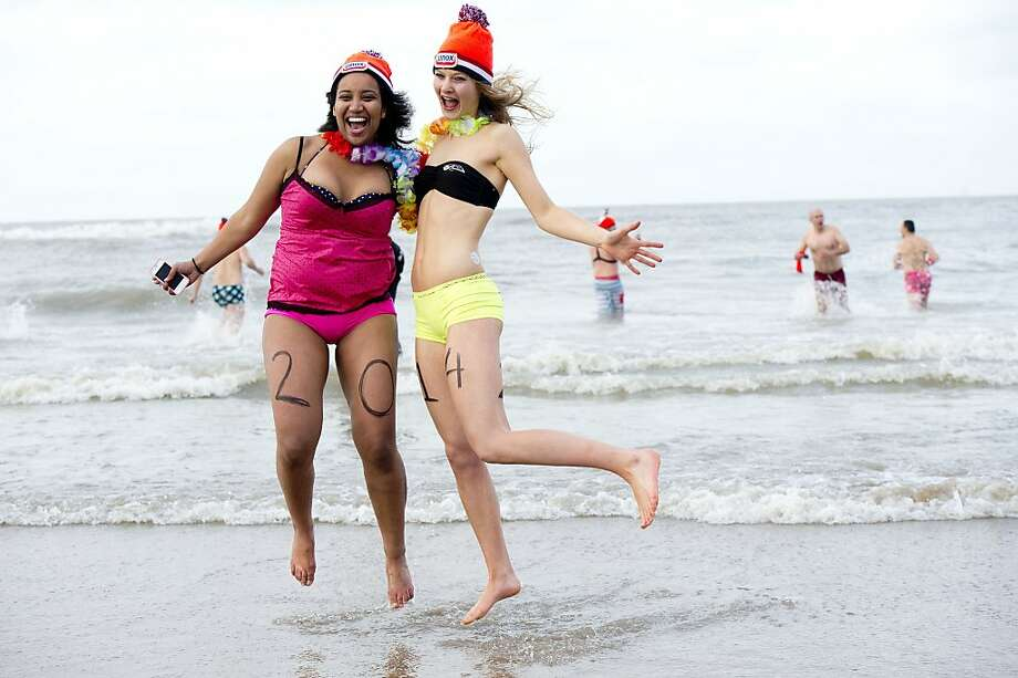 Hoppy New Year! Two Dutch woman get a jump on 2014 during a North Sea dip in Scheveningen, part of the Hague. Photo: Robin Utrecht, AFP/Getty Images