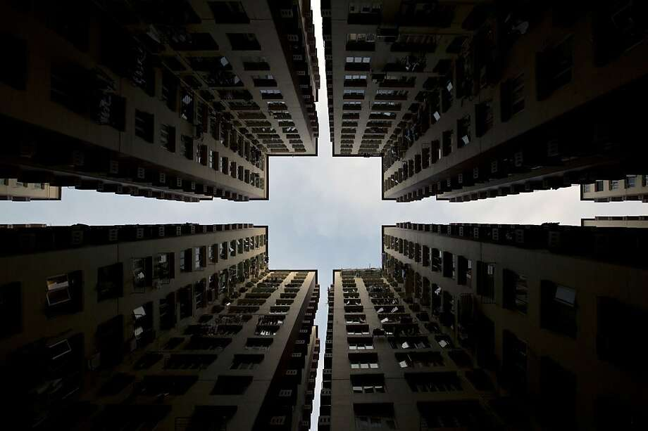 High-rise symmetry: Apartment buildings form a perfect square above a Hong Kong street. Photo: Alex Ogle, AFP/Getty Images