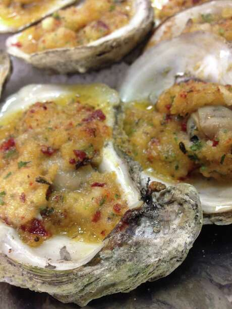 Ostiones Asados -- wood-roasted Gulf oysters with chipotle butter from Caracol, Houston. Photo: Greg Morago / Greg Morago