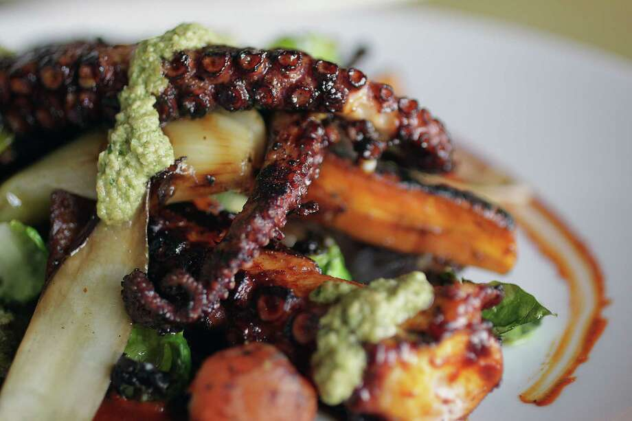 Ensalada de Pulpo, which is a Spanish octopus salad with roasted potato, carrot and celery leaves in pumpkin-seed dressing, at Caracol. Photo: James Nielsen, Staff / © 2013  Houston Chronicle