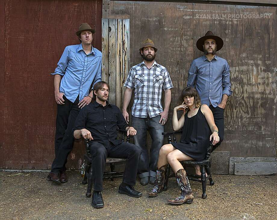 Dead Winter Carpenters:  Sitting: (L to R) -drummer/vocalist   Brian Huston -fiddler/vocalist   Jenni Charles Standing (L to R) -rhythm guitarist/vocalist   Jesse Dunn -upright bassist/vocalist   Dave Lockhart -lead guitarist/vocalist   Bryan Daines Photo: Ryan Salm, Ryan Salm Photography