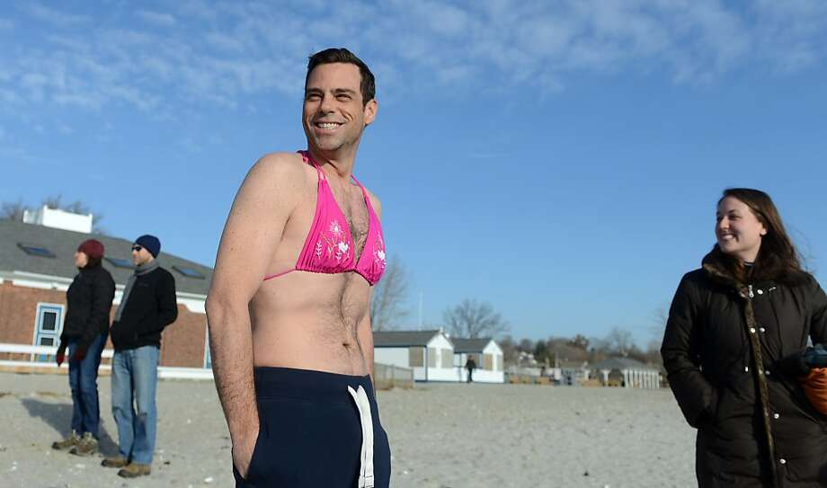 Yes, he lost the bet:We don't know the nature of the wager Wes Sumner made with his wife, but as the winner, she got to pick out this lovely bikini top for him to wear during the Save the Children Mossman Polar Plunge in Westport, Conn. Photo: Autumn Driscoll, Connecticut Post