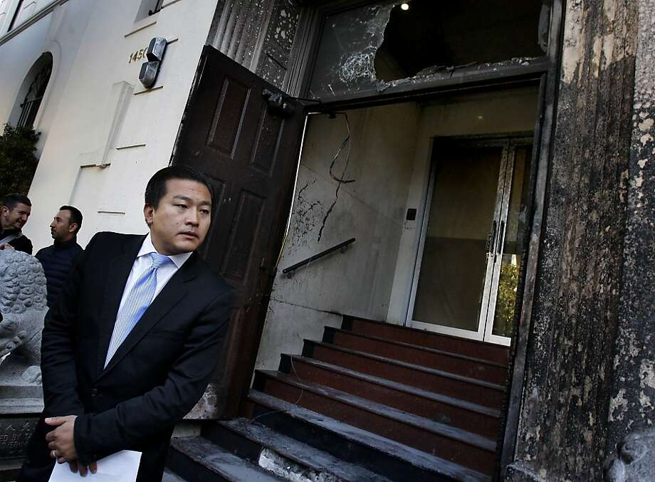 Consulate spokesman Wang Chuan listened to a reporters question as he stood next to the damaged building Thursday January 2, 2014 in San Francisco, Calif. Unidentified persons splashed gasoline on the main entrance to the Chinese consulate on Geary and Laguna Streets and set it ablaze causing damage to the door and exterior. Photo: Brant Ward, The Chronicle