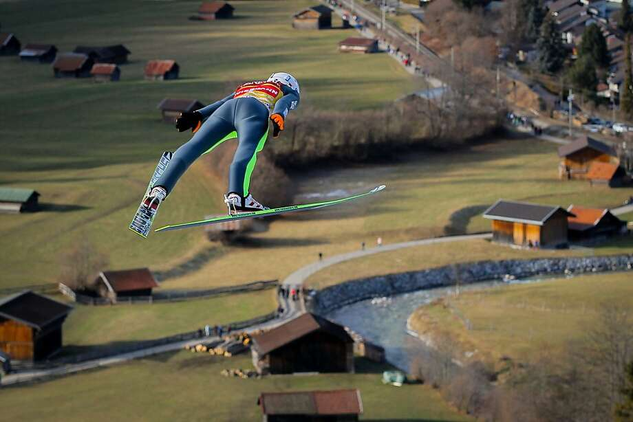 Where did the snow go?!  Kamil Stoch of Poland soars over a landscape that looks more like spring than winter during the FIS Ski Jumping 