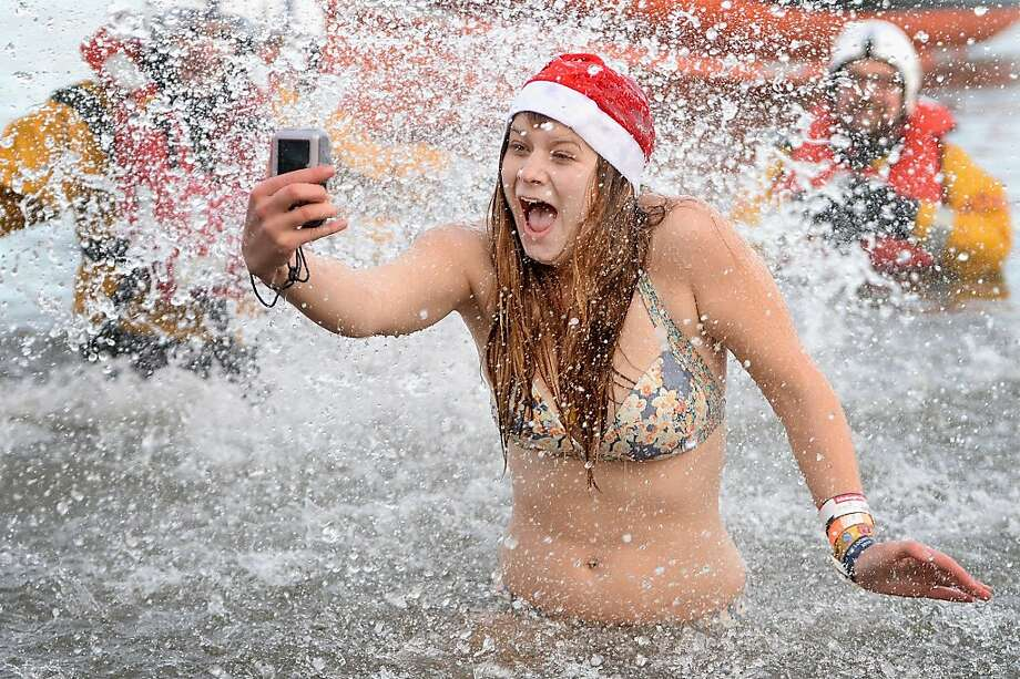 And this is me with hypothermia ... A New Year's Day reveler in South Queensferry, Scotland, takes a selfie of her goosebumps at the Loony Dook Swim in the River Forth. Photo: Jeff J Mitchell, Getty Images