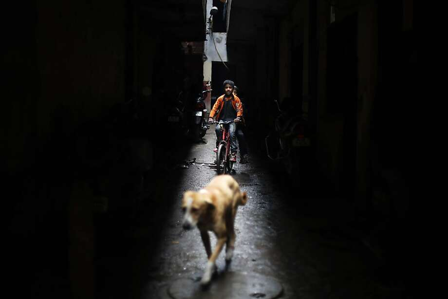 Beep! Beep! Slow-moving traffic blocks an alleyway in New Delhi. Photo: Altaf Qadri, Associated Press