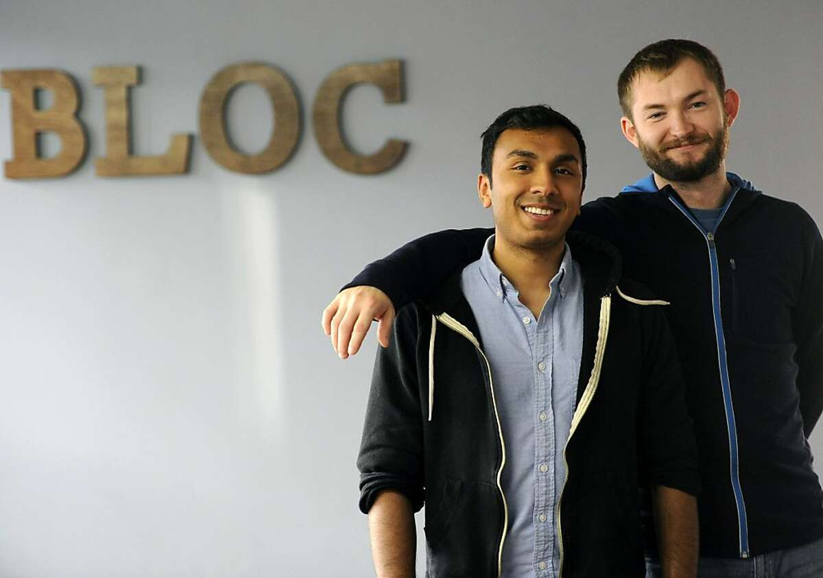 Bloc Co-founders Roshan Choxi and Dave Paola pose for a photo in their new office in San Francisco on December 20, 2013. Bloc is a startup that teaches an intense 12-week course on web development and entrepreneurship.