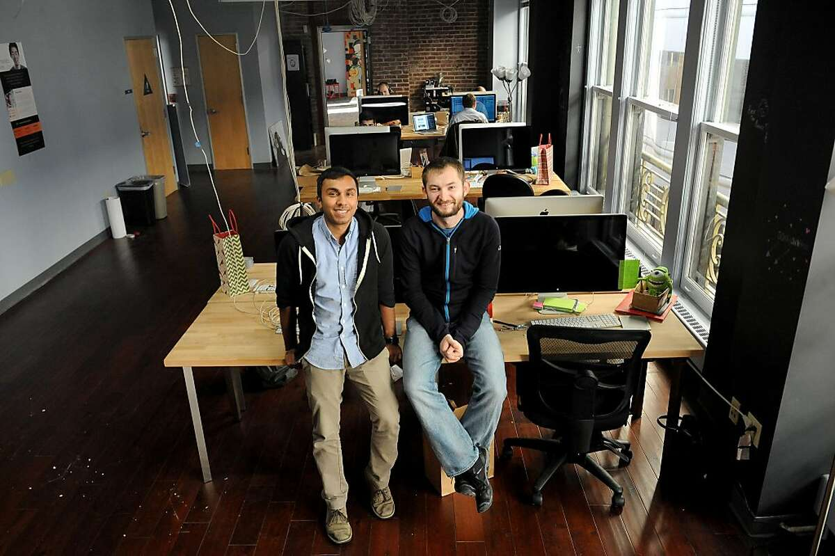 Bloc Co-founders Roshan Choxi (left) and Dave Paola pose for a photo in their new office in San Francisco on December 20, 2013. Bloc is a startup that teaches an intense 12-week course on web development and entrepreneurship.