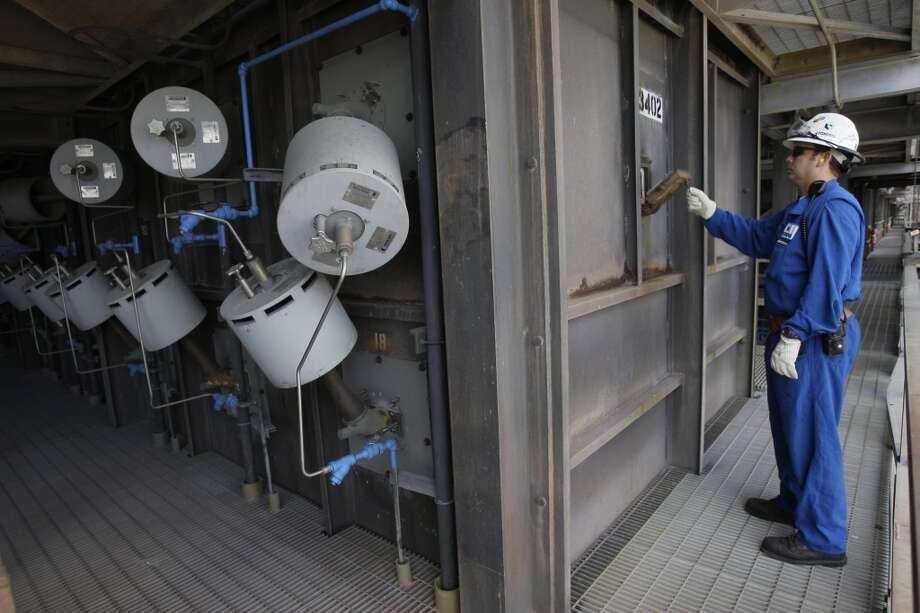 Employee David Martin closes a door of furnace that cracks feedstock at the Olefins 1 ethylene plant at the LyondellBasell chemical plant  Tuesday, June 3, 2008, in Channelview. Photo: Melissa Phillip, Houston Chronicle