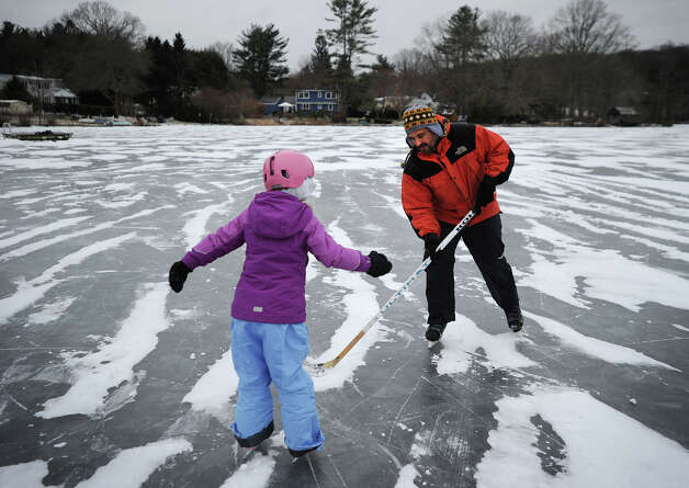 Stephen Mazarelli and his daughter Alexandra, 7, of Easton, enjoy a cold afternoon of skating on the Samp Mortar Reservoir in Fairfield, Conn. on Thursday, January 2, 2014. Photo: Brian A. Pounds / Connecticut Post