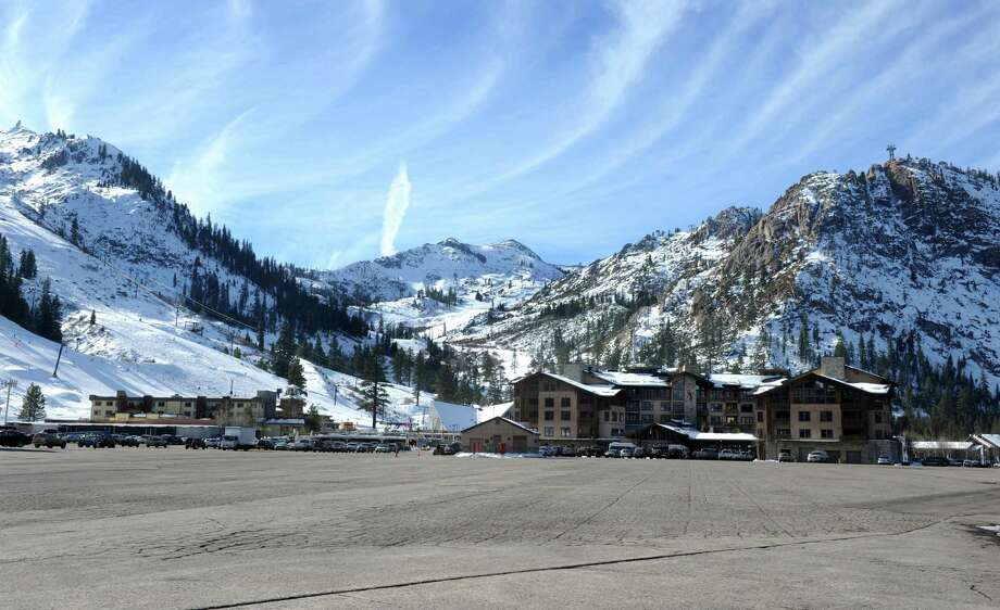 This photo taken on Monday, Dec. 16, 2013, shows the expansive parking lot at the base village at Squaw Valley. Photo: Tim Dunn / Associated Press / Reno Gazette-Journal