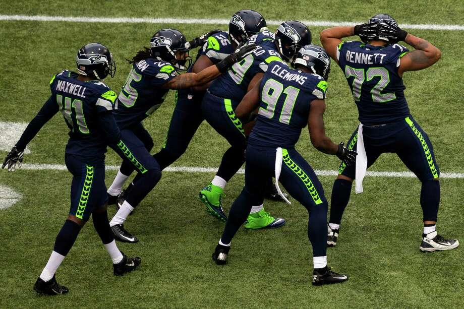 Seahawks celebrate during the first half of the final regular season game Sunday, Dec. 29, 2013, at CenturyLink Field in Seattle. The Seahawks led the Rams 13-0 at the half. Photo: JORDAN STEAD, SEATTLEPI.COM / SEATTLEPI.COM